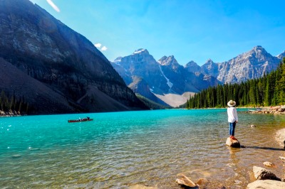 a girl standing on a rock at Moraine Lake, Banff National Park